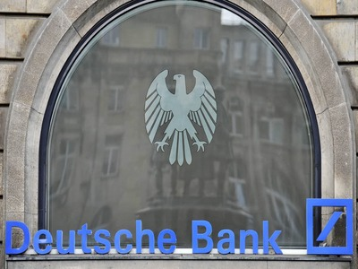 Fitch revises Deutsche Bank rating outlook to positive from negative