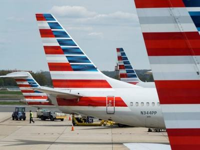 American Airlines posts record annual loss on pandemic pain