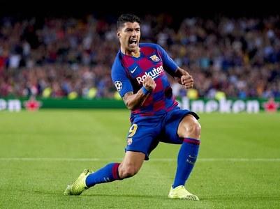 Suarez double at Cadiz sends Atletico 10 points clear