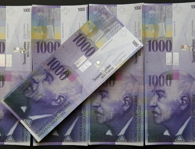 Swiss franc drops to 2-month low, dollar bounces to 2-week high