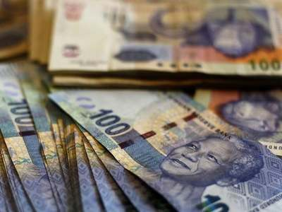 South African rand edges up on vaccine progress, stocks slide