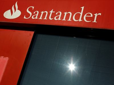 Virus pushes Santander into massive annual loss
