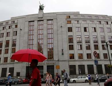 Czech central bank holds fire, markets await rate hike clues