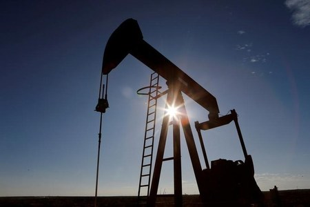 Oil prices rise to highest in a year on U.S. growth optimism, crude supply restraint