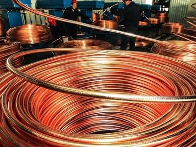 Copper buoyed by sagging dollar and U.S. stimulus hopes