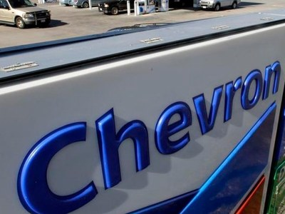 Chevron posts loss on weak refining
