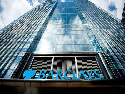 Barclays resumes dividend payouts as annual profit halves