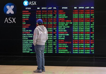 Australia shares track Asian peers lower, commodity stocks weigh
