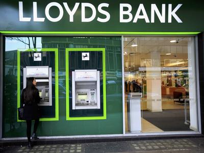 Lloyds profits fall as it targets wealth push