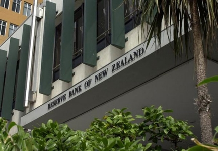 NZ central bank holds fire on rates, tempers tightening expectations