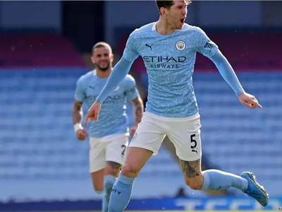 Stones sends Man City 13 points clear