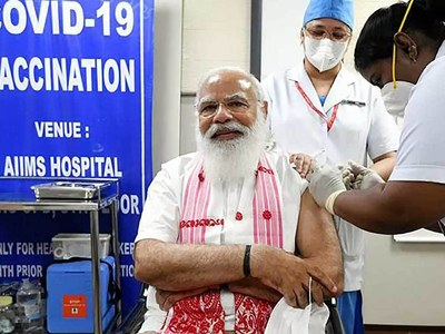 India's Modi gets Covid-19 jab as chaotic expansion of vaccine drive begins