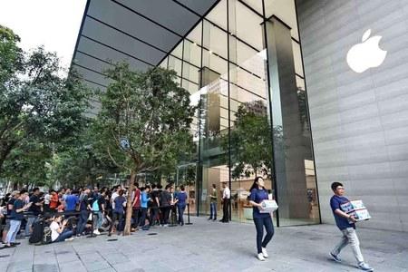 Apple, Tesla pull Wall Street down