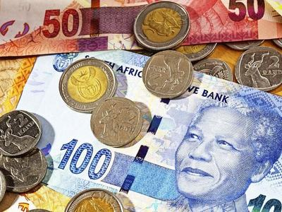 South Africa's rand falls but set for weekly gains