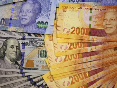 South Africa's rand slips but set for weekly gains