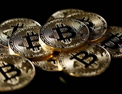 Bitcoin falls back sharply after weekend record