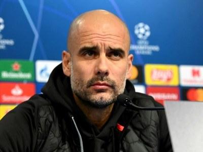 Guardiola says talk of Man City quadruple not realistic