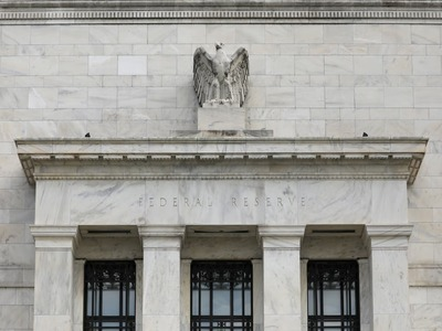 Fed sees higher growth, above target inflation this year, rates remain steady