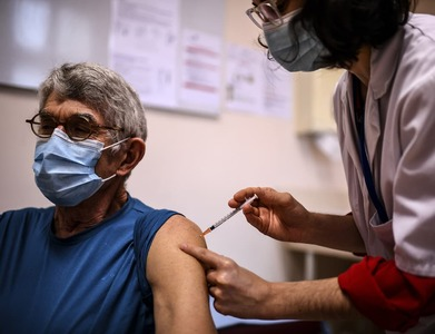 Britain hits milestone as half of all adults get first vaccine dose
