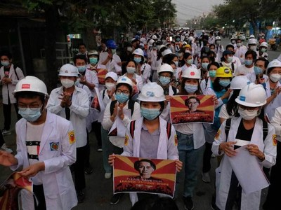 Protester shot dead in central Myanmar and two Australians in custody
