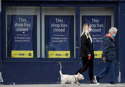 UK jobless rate falls as workers drop out of labour force