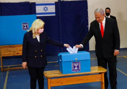 Israel votes as Netanyahu hopes vaccine rollout overcomes corruption trial