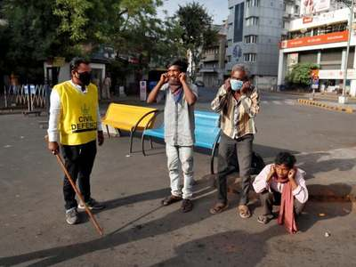 India locks down some towns as coronavirus cases hit 5-month high
