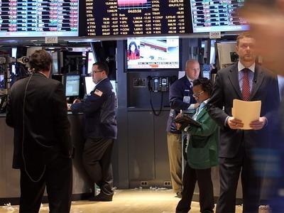 Wall Street climbs on boost from financials, tech stocks