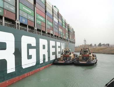 Salvager hopes to free ship blocking Suez Canal by start of next week