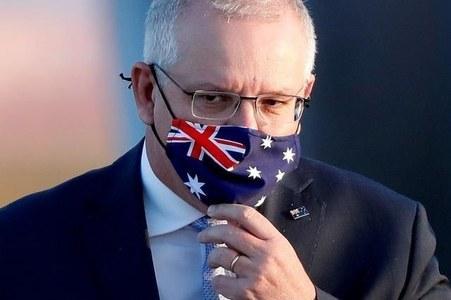 Australian PM promotes women in cabinet reshuffle amid poll slump