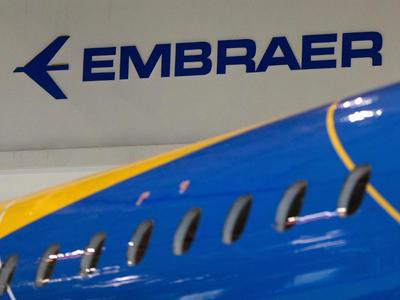 Embraer cuts losses