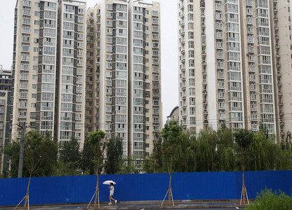 China's home prices extend gains in March, defy renewed curbs
