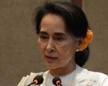 Junta says Suu Kyi broke secrets law, international pressure rises