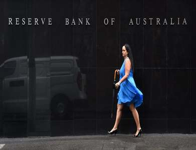 Australia central bank cautions about housing boom as rates held at record lows