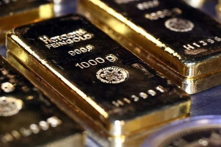 Gold eases from 2-week high as economic recovery hopes grow