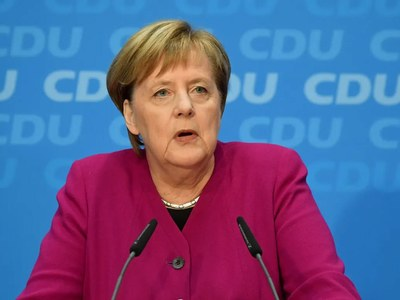 Merkel party chief swings ahead in race to be next chancellor