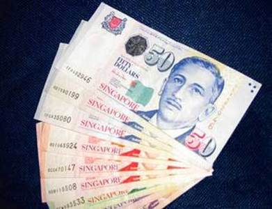 Singapore dollar gains slightly after central bank stands pat, GDP surprise