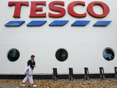 Tesco sales surge but COVID costs wipe out fifth of pretax profit