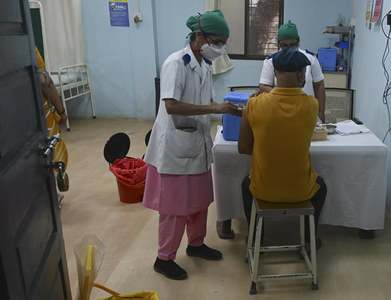 India's vaccinations fall from peak, raw-material shortage hits output targets