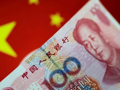 Yuan breaches key threshold, edges up to month high