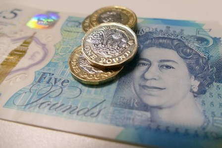 Sterling holds ground as UK inflation ticks higher