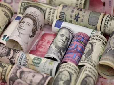 Dollar falls as US yields languish, euro gets boost from survey