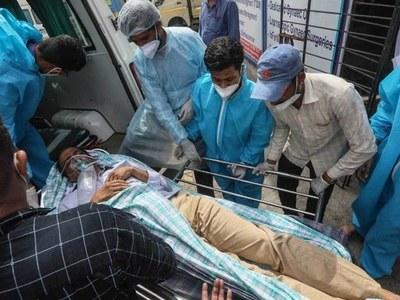 India's death toll hits new record as Covid 'tsunami' worsens