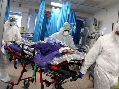 India infections top 18m as gravediggers work round the clock