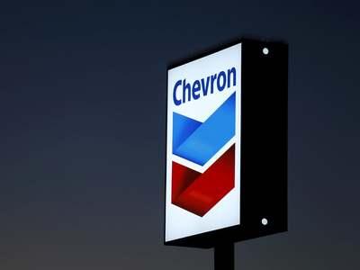 Chevron profit drops on weaker refining margins, storm hit