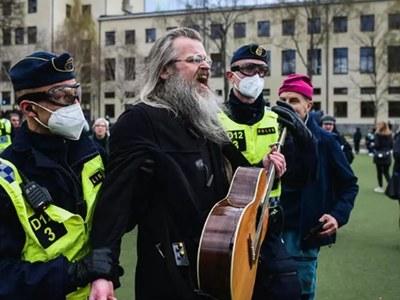 Hundreds protest virus measures in Finland, Sweden