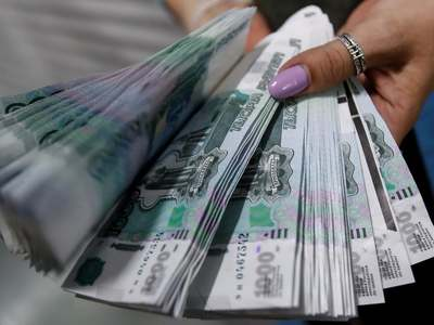 Russian rouble firms past 75 vs dollar, stocks climb