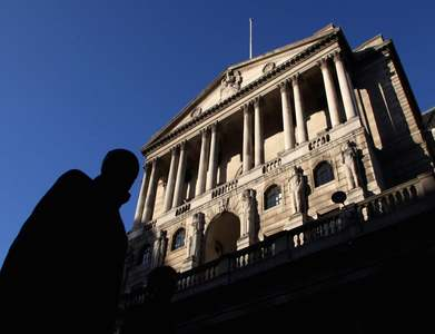Bank of England flags slower bond-buying as economy recovers