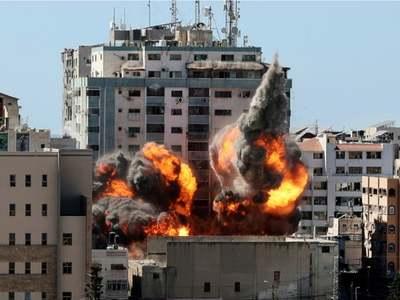 Israel pounds Gaza, hits media building housing AP and Jazeera