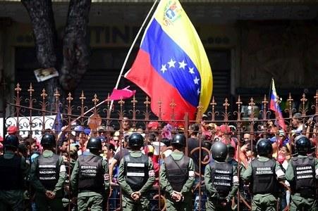 Venezuela paper seized in defamation case filed by top leader